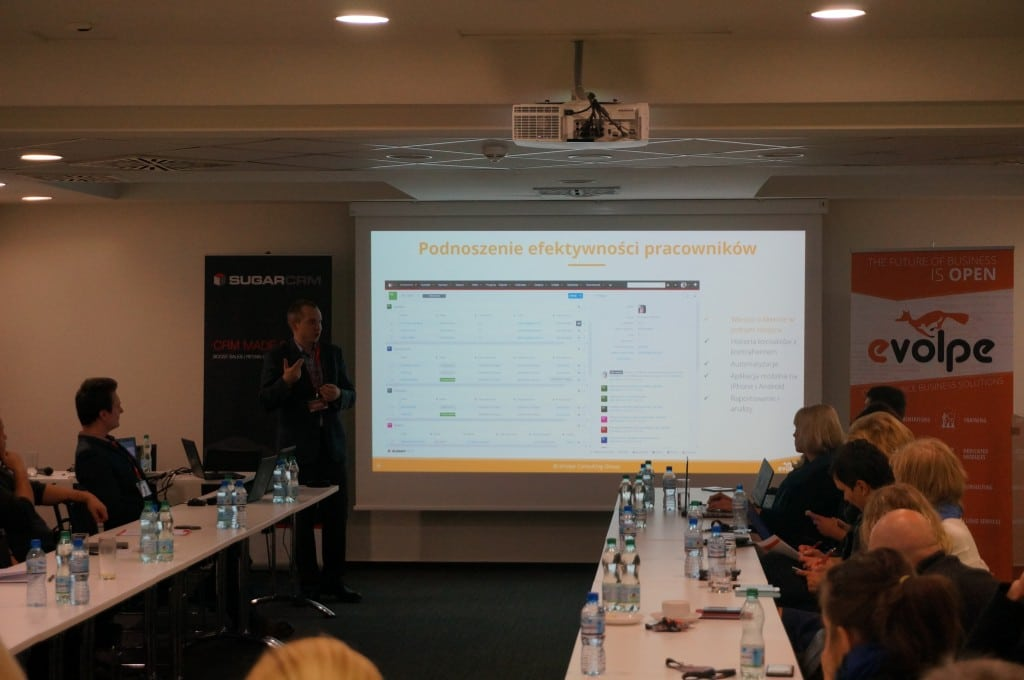 "Łukasz Taranta during the presentation on the ""Effective Sales Management with SugarCRM"" conference."